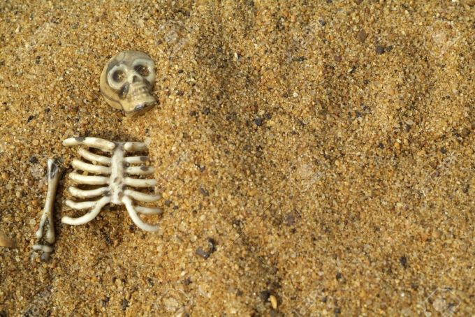 3447533-Buried-skeleton-bones-background-Stock-Photo